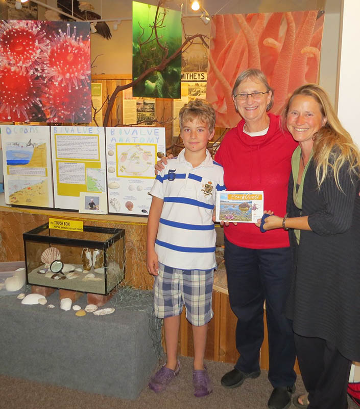 Connor, mom, and Carroll Hodge with clam exhibit